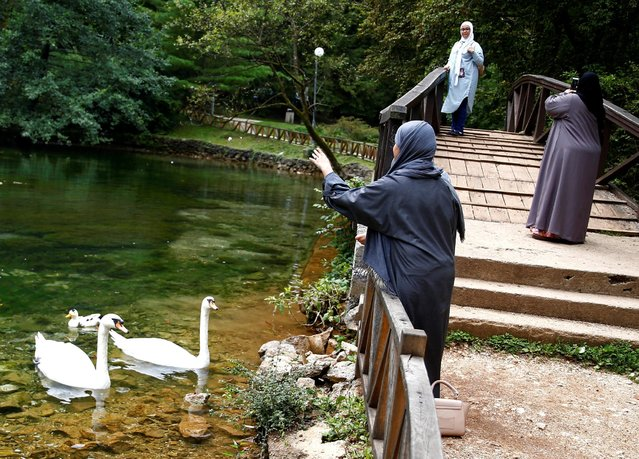 Tourists from the Middle East enjoy at Vrelo Bosne nature park in Ilidza near Sarajevo, Bosnia and Herzegovina, August 19, 2016. (Photo by Dado Ruvic/Reuters)