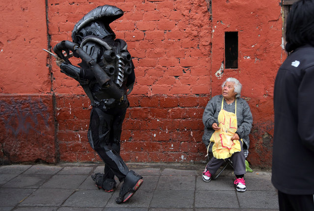 A person dressed as in movie costume walks near Saint Rose's Church during celebrations of the anniversary of Santa Rosa de Lima (Saint Rose of Lima), patroness of Latin America and the Philippines, in Lima, Peru, August 30, 2016. (Photo by Mariana Bazo/Reuters)
