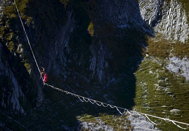 Samuel Volery of Switzerland walks on the 495-metre (1,624 ft) line during the Highline Extreme event in Moleson, Switzerland September 25, 2015. (Photo by Denis Balibouse/Reuters)