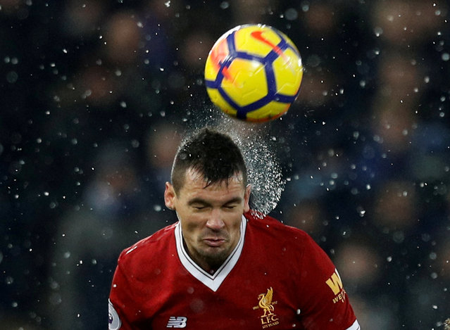 Liverpool' s Croatian defender Dejan Lovren in action during the English Premier League football match between Liverpool and Everton at Anfield in Liverpool, north west England on December 10, 2017. (Photo by Phil Noble/Reuters)