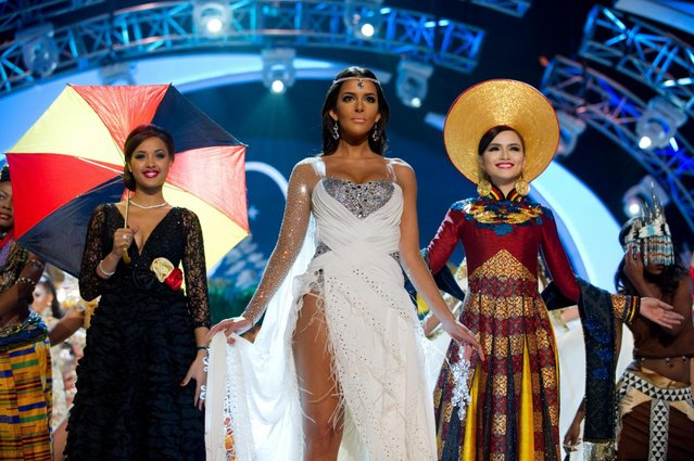 Miss Belgium 2012, Laura Beyne; Miss Finland 2012, Sara Chafak; and Miss Korea 2012, Sung-hye Lee, perform onstage at the 2012 Miss Universe National Costume Show on Friday, December 14, 2012 at PH Live in Las Vegas, Nevada. The 89 Miss Universe Contestants will compete for the Diamond Nexus Crown on December 19, 2012. (Photo by AP Photo/Miss Universe Organization L.P., LLLP)