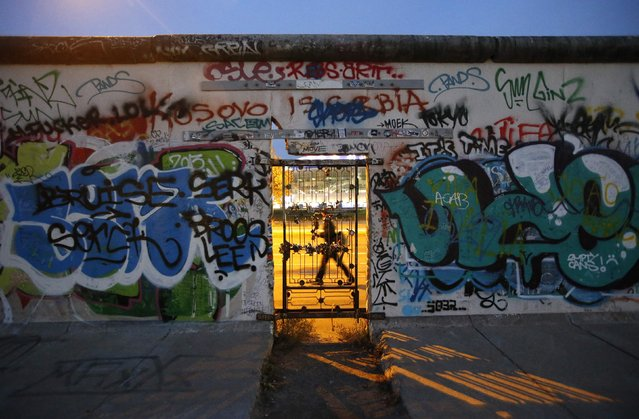 A door is seen at painted sections of the East Side Gallery, the largest remaining part of the former Berlin Wall, in Berlin, November 3, 2014. Germany will celebrate the 25th anniversary of the fall of the wall on November 9. (Photo by Fabrizio Bensch/Reuters)