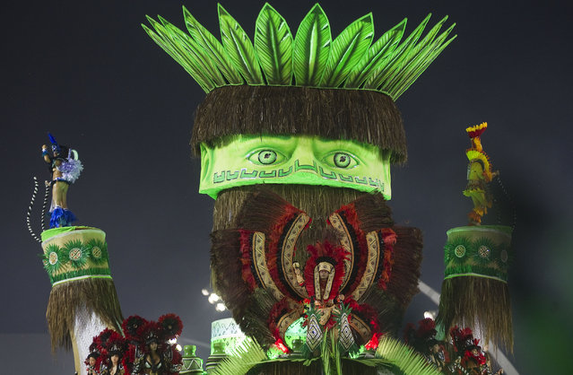 Dancers from the X-9 Paulistana samba school perform on a float during a carnival parade in Sao Paulo, Brazil, early Saturday, February 9, 2013. (Photo by Andre Penner/Associated Press)