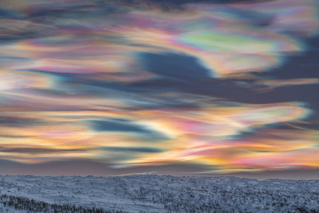 Skyscapes winner: Painting the Sky by Thomas Kast (Germany). The photographer was searching for clear skies in Finnish Lapland to capture the beauty of a polar night and could not believe his eyes when he saw what was waiting behind the clouds. Polar stratospheric clouds are something Kast had been searching for many years and had seen only in photographs until that day. He took his camera on to a frozen river to get a good view and started to take photos. The clouds slowly changed their shape and colours to create a painterly image. (Photo by Thomas Kast/2020 Astronomy Photographer of the Year)