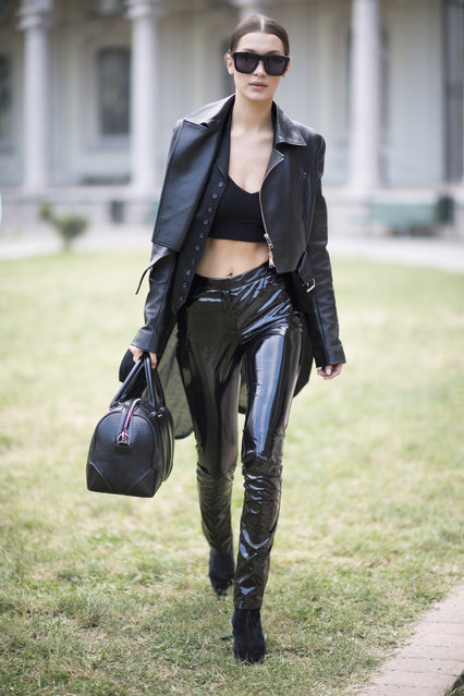 Bella Hadid is wearing a leather jacket and latex pants during Milan Fashion Week Spring/Summer 2017 on September 21, 2016 in Milan, Italy. (Photo by Timur Emek/Getty Images)