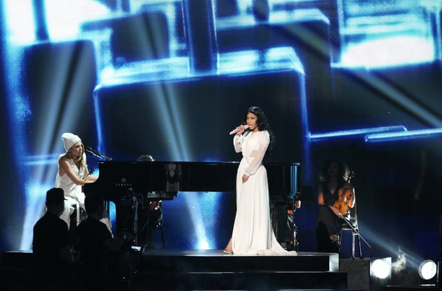 Skylar Grey, left, and Nicki Minaj perform at the 42nd annual American Music Awards at Nokia Theatre L.A. Live on Sunday, November 23, 2014, in Los Angeles. (Photo by Matt Sayles/Invision/AP Photo)