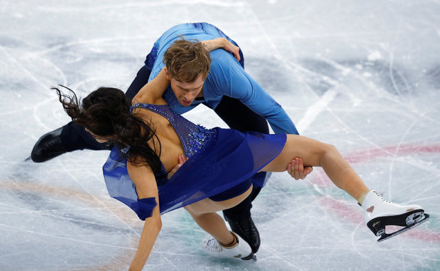 USA' s Madison Chock and USA' s Evan Bates fall in the ice dance free dance of the figure skating event during the Pyeongchang 2018 Winter Olympic Games at the Gangneung Ice Arena in Gangneung on February 20, 2018. (Photo by Phil Noble/Reuters)