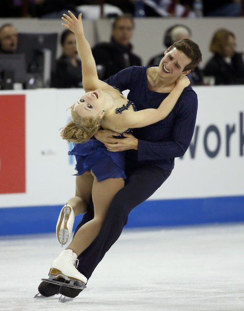Julianne Seguin and Charlie Bilodeau of Canada perform during the pairs free skate program at the Skate America figure skating competition in Milwaukee, Wisconsin October 24, 2015. (Photo by Lucy Nicholson/Reuters)