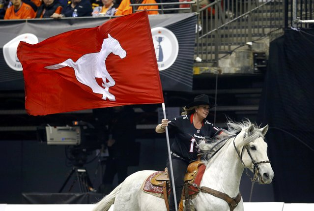 A horse is ridden along the sidelines after a touchdown by the Calgary Stampeders during the CFL's 102nd Grey Cup football championship against the Hamilton Tiger Cats in Vancouver, British Columbia, November 30, 2014. (Photo by Mark Blinch/Reuters)