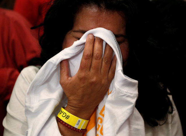 "A supporter of ""Si"" vote cries after the nation voted  ""NO"" in a referendum on a peace deal between the government and Revolutionary Armed Forces of Colombia (FARC) rebels, at Bolivar Square in Bogota, Colombia, October 2, 2016. (Photo by John Vizcaino/Reuters)"