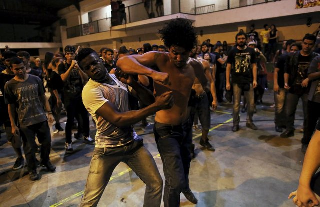 Heavy metal fans dance during a fund raising concert for Syrian refugees in Brazil, in Rio de Janeiro November 8, 2015. (Photo by Nacho Doce/Reuters)