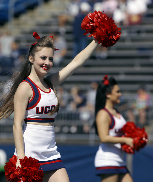 Connecticut cheerleaders perform before an NCAA college football game between Connecticut and Virginia at Pratt & Whitney Stadium at Rentschler Field Saturday, September 17, 2016, in East Hartford, Conn. (Photo by Bill Sikes/AP Photo)