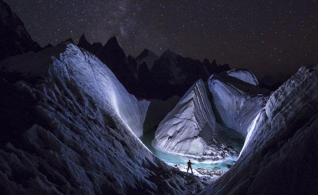 A photographer uses LED light to 'paint' the snow at Karakoram. (Photo by David Kaszlikowski/Rex Features)