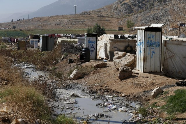 Toilets donated by Unicef and World Vision stand near tents at a Syrian refugee settlement camp in Qab Elias in the Bekaa Valley, near Baalbek, Lebanon October 17, 2015. (Photo by Jamal Saidi/Reuters)
