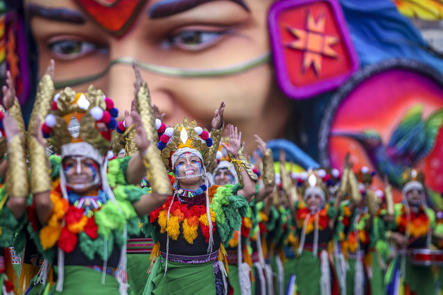 Artists perform during the Blacks and Whites Carnival in Pasto, Colombia on January 6, 2021. - Carnivals are held without public as a preventive measure against the spread of COVID-19 coronavirus pandemic. (Photo by Daniel Rivera/AFP Photo)
