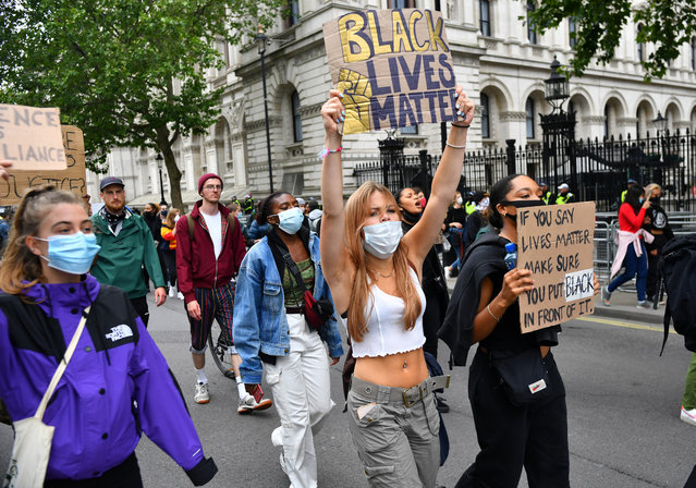 Demonstrators hold up signs as they march during a Black Lives Matter protest in London, following the death of George Floyd who died in police custody in Minneapolis, London, Britain, June 12, 2020. (Photo by Dylan Martinez/Reuters)