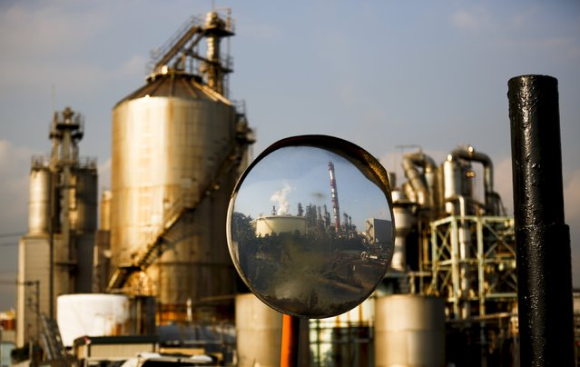 A factory is reflected in a traffic mirror at the Keihin industrial zone in Kawasaki, south of Tokyo, November 30, 2015. Japan's industrial output rose for a second straight month in October and retail sales grew much faster than expected - a tentative sign of the economy's recovery from a recession. (Photo by Thomas Peter/Reuters)