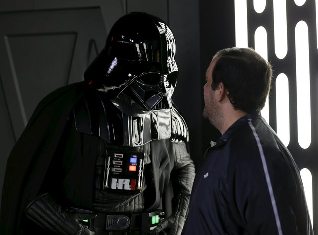 A guest interacts with the character Darth Vader during the Star Wars Launch Bay grand opening at Disney's Hollywood Studios in Orlando, Florida December 4, 2015. (Photo by Scott Audette/Reuters)