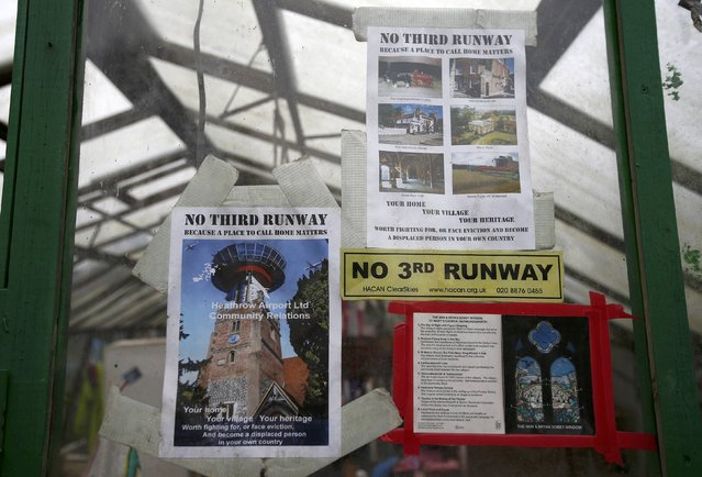 Posters against Heathrow expansion hang at the 'Grow Heathrow' protest camp in the village of Sipson near to Heathrow Airport, west London Britain December 7, 2015. (Photo by Peter Nicholls/Reuters)