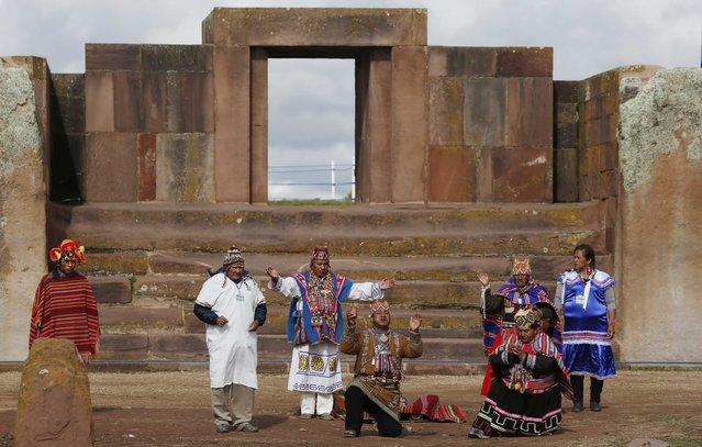 Aymaran spiritual guides begin the ceremonial swearing-in for Bolivia's President Evo Morales, at the archeological site Tiwanaku, Bolivia, Wednesday, January 21, 2015. (Photo by Juan Karita/AP Photo)