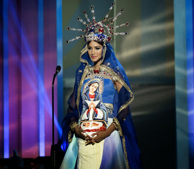 Miss Dominican Republic, Kimberly Castillo, poses for the judges, during the national costume show during the 63rd annual Miss Universe Competition in Miami, Fla., Wednesday, January 21, 2015. (Photo by J. Pat Carter/AP Photo)