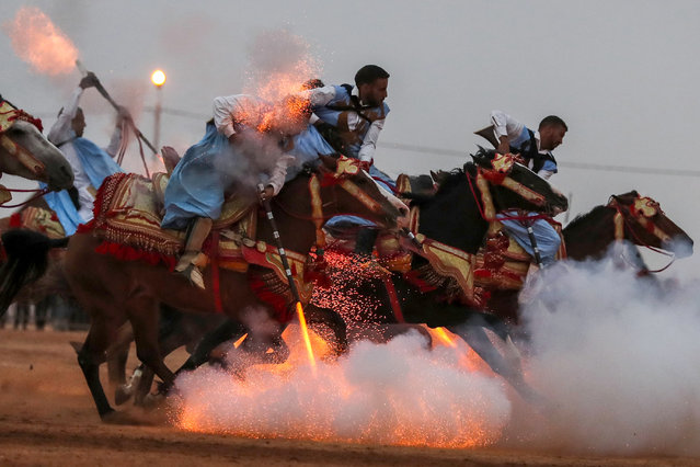 "Horsemen ride in a choreographed cavalry charge in a fantasia during the 14th Tan-Tan Moussem Berber festival on July 8, 2018 in the western Moroccan desert town of Tan-Tan. The festival, which is recognised by UNESCO as a ""Masterpiece of the Oral and Intangible Heritage of Humanity"", is organised every year to promote local traditions and brings together nomadic tribes from northern Africa. (Photo by Karim Sahib/AFP Photo)"