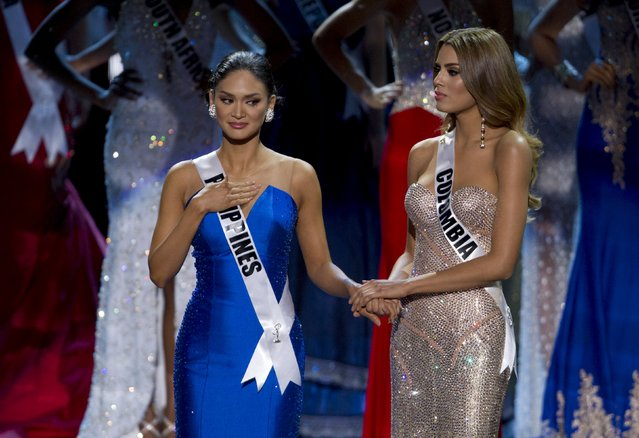 Miss Philippines Pia Alonzo Wurtzbach (L) waits with Miss Colombia Ariadna Gutierrez before Miss Colombia was initially announced as Miss Universe during the 2015 Miss Universe Pageant in Las Vegas, Nevada, December 20, 2015. Host Steve Harvey said he made a mistake when reading the card and Miss Philippines Pia Alonzo Wurtzbach is the actual winner. (Photo by Steve Marcus/Reuters)