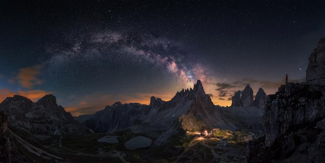 This panoramic image, composed out of eight photos, depicts the Milky Way emerging over the rocky Dolomites in Tre Crime. (Photo by Carlos F. Turienzo/Astronomy Photographer of the Year 2018)