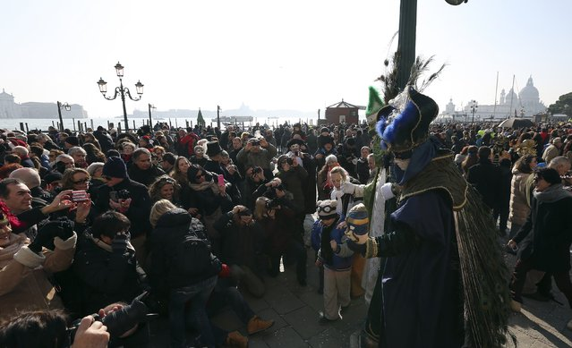 A masked reveller poses at Saint Mark's square during Carnival in Venice, February 8, 2015. (Photo by Stefano Rellandini/Reuters)