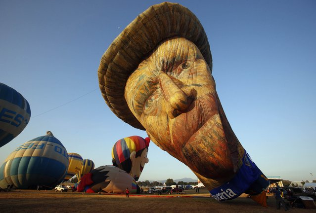 A view of a Van Gogh-inspired hot air balloon being inflated during the Philippine International Hot Air Balloon Fiesta at Clark Freeport Zone in Pampanga province, north of Manila February 12, 2015. According to the organizer, a total of 32 hot air balloons are part of the four-day event. (Photo by Erik De Castro/Reuters)