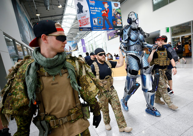 Cosplayers are seen during the media day of the world's largest computer games fair Gamescom in Cologne, Germany,  August 21, 2018. (Photo by Wolfgang Rattay/Reuters)