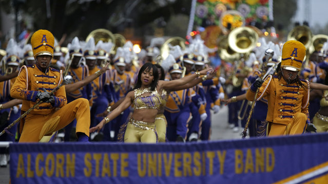 Members of the Alcorn State University Band march in the Krewe of Proteus Mardi Gras parade in New Orleans, Monday, February 16, 2015. (Photo by Gerald Herbert/AP Photo)
