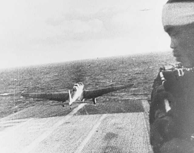 A Japanese Navy Type 97 Kate carrier attack plane takes off from the aircraft carrier Shokaku, en route to attack Pearl Harbor, Hawaii, U.S. December 7, 1941. (Photo by Reuters/U.S. Navy/National Archives)