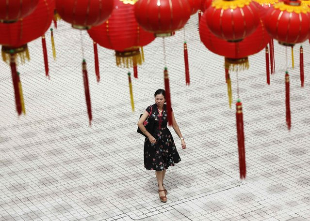 A woman walks under lanterns on Chinese New Year at the Thean Hou temple in Kuala Lumpur, February 19, 2015. (Photo by Olivia Harris/Reuters)