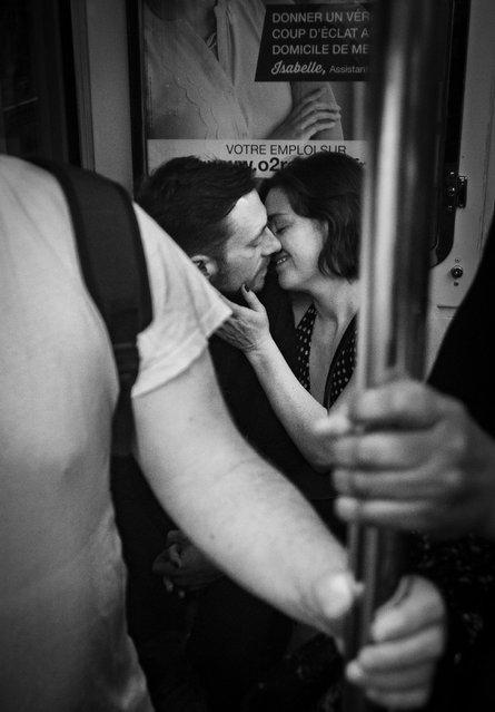 A couple on the Paris Métro. #Love shortlist. (Photo by Guilhem Dijoux/@guilhphoto)