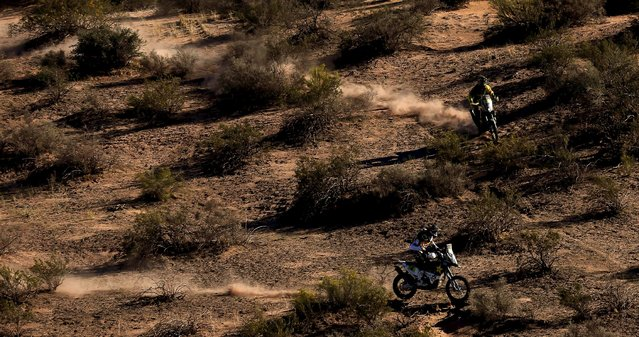Pablo Quintanilla (bottom) of Chile rides his Huqsvarna past Stefan Svitko of Slovakia on his KTM during the ninth stage of the Dakar Rally 2016 near Belen, Argentina, January 12, 2016. (Photo by Marcos Brindicci/Reuters)