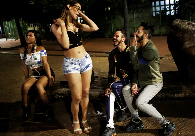 Jorge (2nd R), 31, who is among members of lesbian, gay, bisexual and transgender (LGBT) community and his brother Paulo, 28, (R) laugh at Arouche Square in downtown Sao Paulo, Brazil, November 20, 2016. (Photo by Nacho Doce/Reuters)