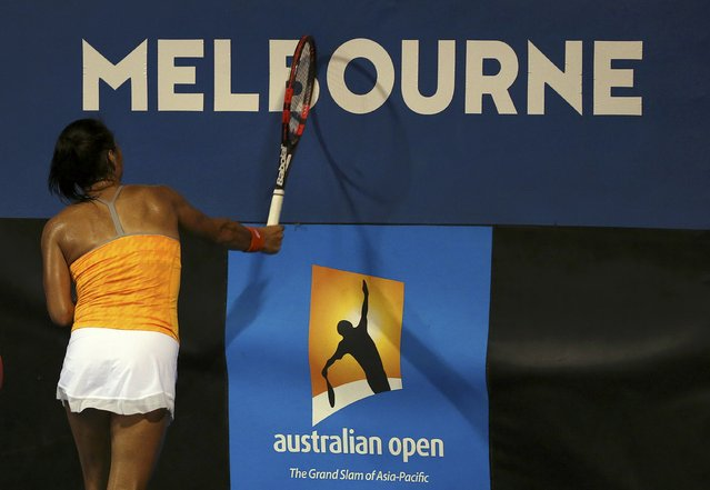 Britain's Heather Watson smashes her racquet into the signage during her first round match against Hungary's Timea Babos at the Australian Open tennis tournament at Melbourne Park, Australia, January 18, 2016. (Photo by Jason O'Brien/Reuters)
