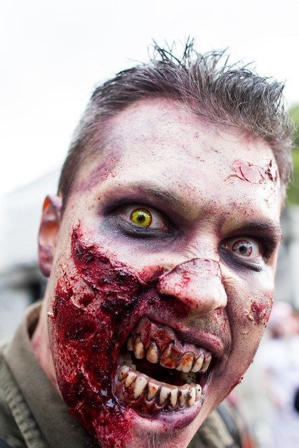 A participant pictured dressed as a zombie during World Zombie Day in London. (Photo by Michael Mba/Demotix/Corbis)