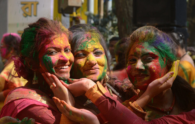 Indian revellers cover each other with coloured powder during the celebrations of Vasantotsav, 'the Festival of Spring', in Siliguri on March 5, 2015. Vasantotsav, which is celebrated in the rest of India as Holi, is celebrated as a welcoming of Spring and a celebration of the triumph of good over evil with people chasing each other and playfully splashing colorful paint, powder and water on each other. AFP PHOTO / Diptendu DUTTA        (DIPTENDU DUTTA/AFP/Getty Images)