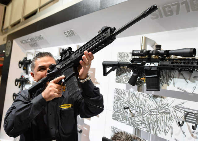 Glen Kukula checks out a Patrol SIG716 rifle by Sig Sauer at the 2016 National Shooting Sports Foundation's Shooting, Hunting, Outdoor Trade (SHOT) Show at the Sands Expo and Convention Center on January 19, 2016 in Las Vegas, Nevada. (Photo by Ethan Miller/Getty Images)