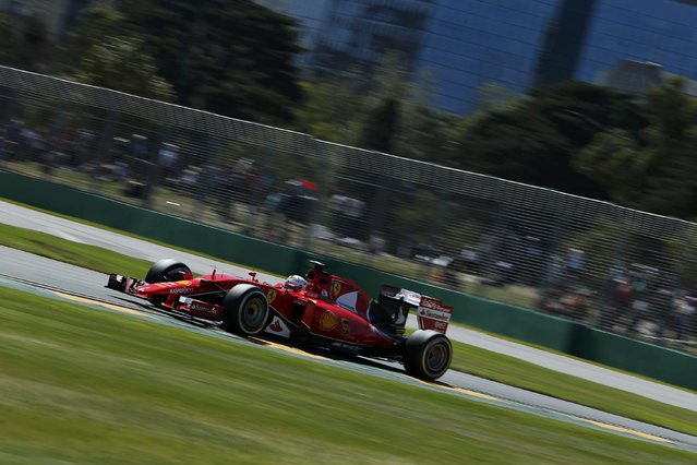 Ferrari Formula One driver Sebastian Vettel of Germany drives during the first practice session of the Australian F1 Grand Prix at the Albert Park circuit in Melbourne March 13, 2015. REUTERS/Jason Reed