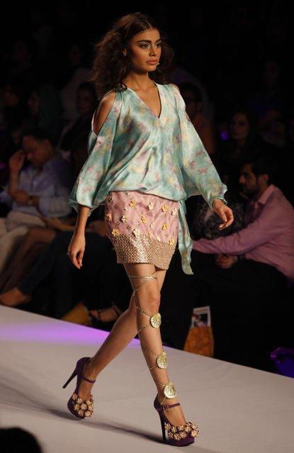A model presents creations by Pakistani designer Wardha Saleem at Fashion Pakistan Week 2015 , Thursday, April 2, 2015 in Karachi, Pakistan. (Photo by Shakil Adil/AP Photo)