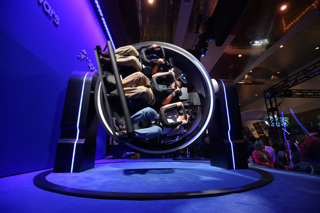 Attendees try out the Samsung Gear VR 4D Experience during the 2017 CES in Las Vegas, U.S., January 5, 2017. (Photo by Steve Marcus/Reuters)