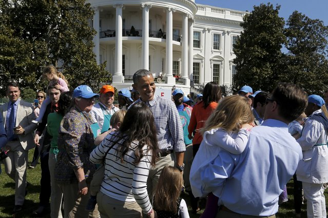 U.S. President Barack Obama (C) greets children and volunteers during the annual Easter Egg Roll at the White House in Washington April 6, 2015. (Photo by Jonathan Ernst/Reuters)