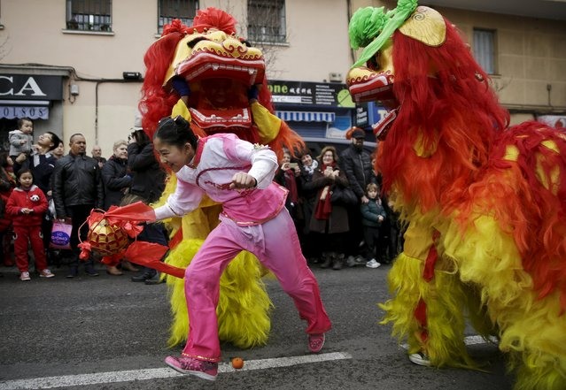 People perform during a parade to celebrate the Chinese Lunar New Year, which welcomes the Year of the Monkey, in Madrid, Spain, February 13, 2016. (Photo by Andrea Comas/Reuters)