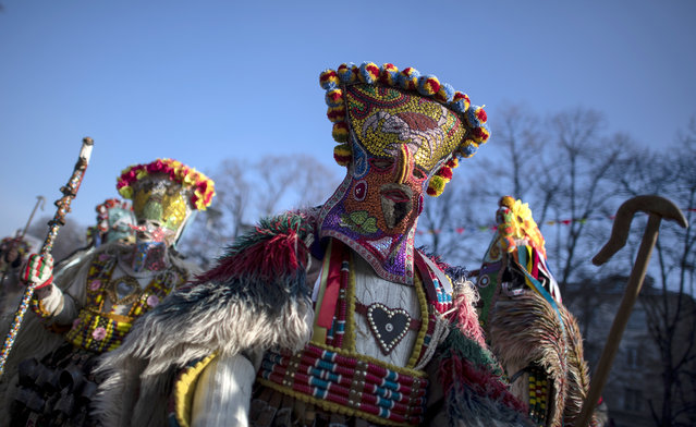 """Mask dancers take part in a parade during the the International Festival of Masquerade Games """"Surva"""" in the town of Pernik, some 30 km from Sofia, Bulgaria, 27 January 2019. (Photo by Vassil Donev/EPA/EFE)"""