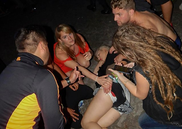 An injured woman is pictured near the Blue Parrot nightclub in Playa del Carmen, Quintana Ro state, Mexico where 5 people were killed, three of them foreigners, during a music festival on January 16, 2017. A shooting erupted at an electronic music festival in the Mexican resort of Playa del Carmen early Monday, leaving at least five people dead and sparking a stampede, the mayor said. Fifteen people were injured, some in the stampede, after at least one shooter opened fire before dawn at the Blue Parrot nightclub during the BPM festival. (Photo by Victor Vargas/AFP Photo)