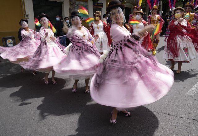 Dancers perform to celebrate the National Day of the Morenada Dance in La Paz, Bolivia, Tuesday, September 7, 2021. La Morenada is a folk dance from the Andes that was inspired by slaves brought to the region during the colonial era. (Photo by Juan Karita/AP Photo)