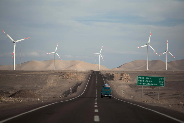 Wind mills producing renewable energy are seen in the eolic park of the Valle de los vientos (Valley of the winds) in the II Antofagasta region, northern Chile January 7, 2016. (Photo by Pablo Sanhueza/Reuters)